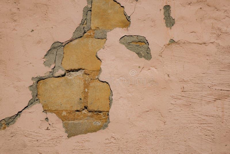 Fondo di struttura del muro di mattoni della crepa fotografia stock