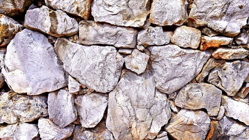 Fondo di struttura del muro di mattoni della roccia immagini stock