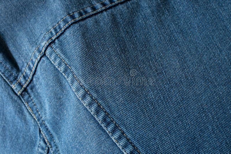 Fondo di struttura del primo piano delle blue jeans fotografia stock libera da diritti