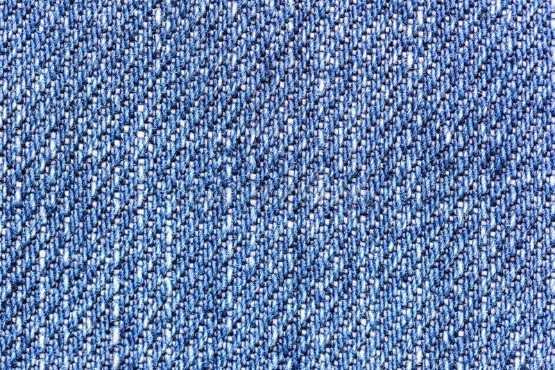 Fondo di struttura del tessuto dei jeans del denim per abbigliamento, progettazione di modo ed il concetto della costruzione di i fotografia stock libera da diritti