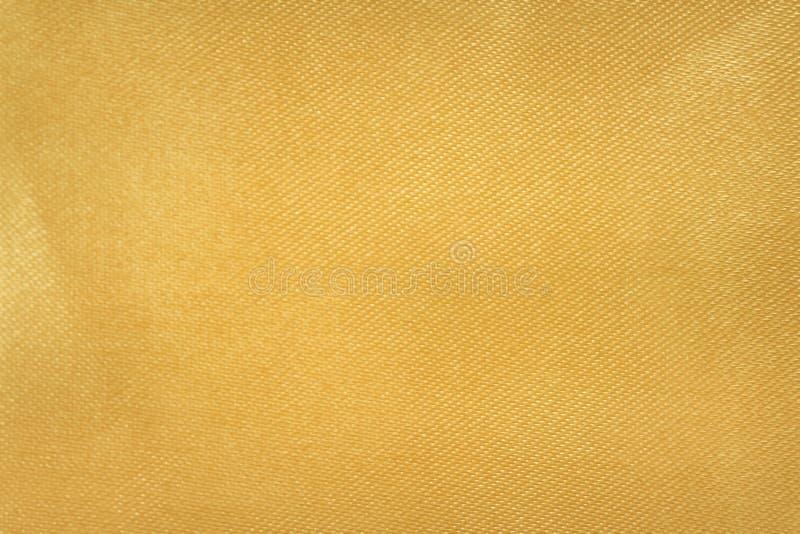 Fondo di struttura del tessuto dell'oro immagini stock