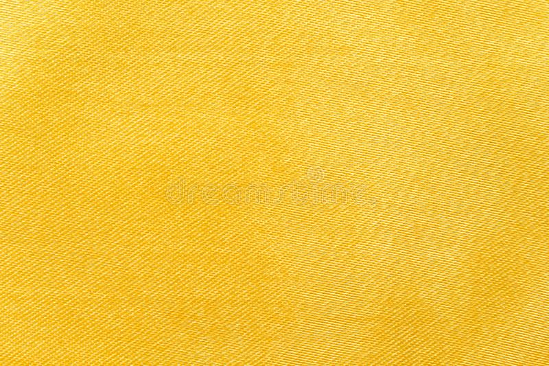 Fondo di struttura del tessuto dell'oro fotografia stock