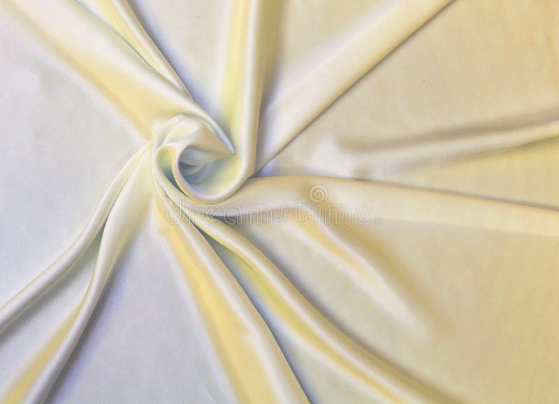 Fondo di struttura del tessuto dell'oro, tessuto ondulato immagine stock