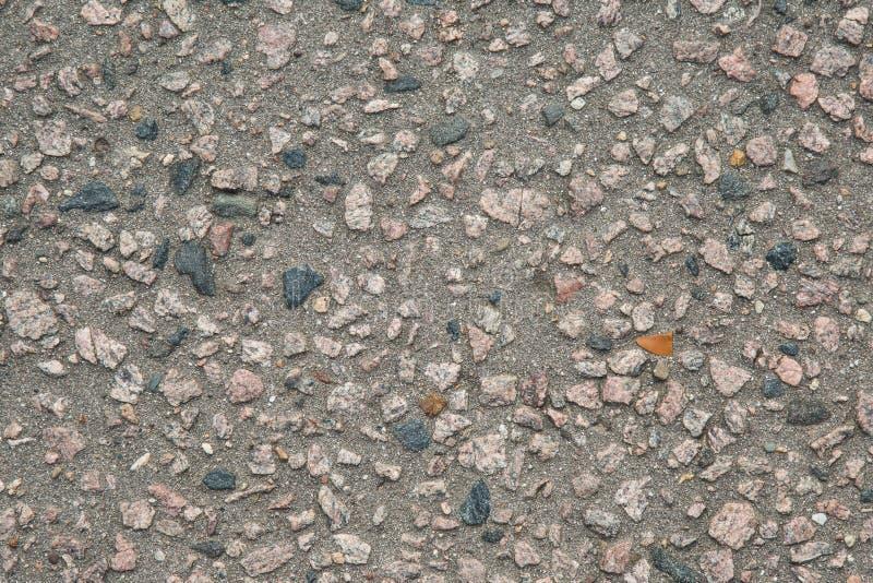 Fondo di struttura dell'asfalto con l'aggiunta della pietra fotografia stock libera da diritti