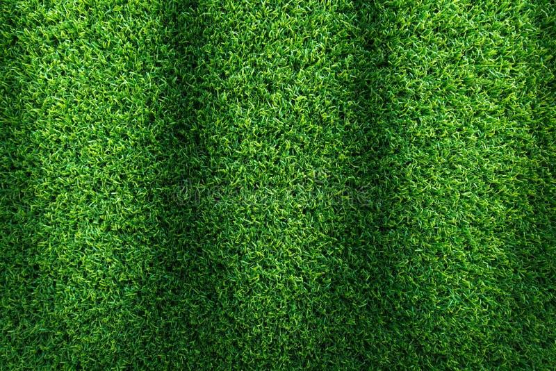 Fondo di struttura dell'erba per progettazione di massima del campo da golf, del campo di calcio o di sport Erba verde artificial fotografie stock libere da diritti