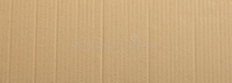 Fondo di struttura della carta kraft del cartone, insegna, vista del primo piano fotografie stock