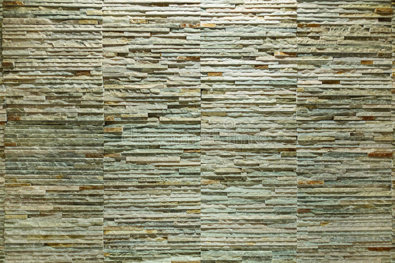 Fondo di struttura della parete dalla fine u dell'ardesia delle mattonelle del mattone della pietra della roccia fotografia stock