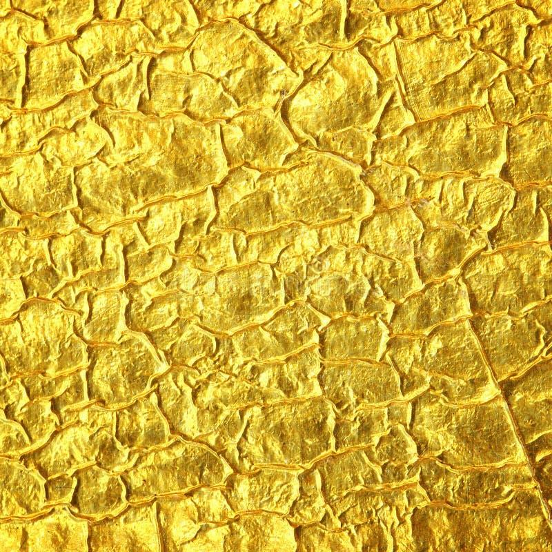 Fondo di struttura della stagnola di oro fotografia stock