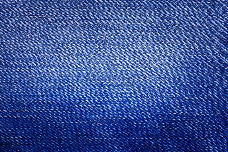 Fondo di struttura delle blue jeans fotografie stock