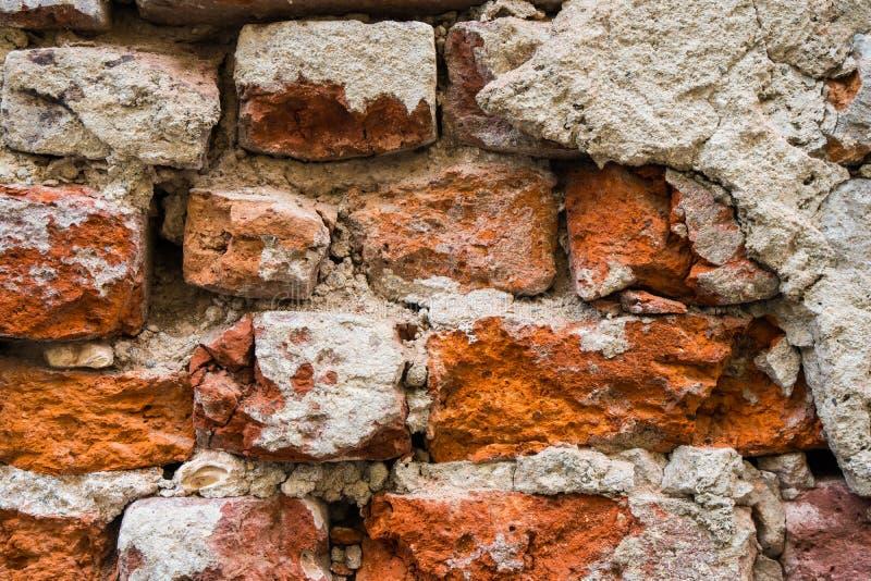 Fondo di vecchia struttura del muro di mattoni della crepa fotografie stock