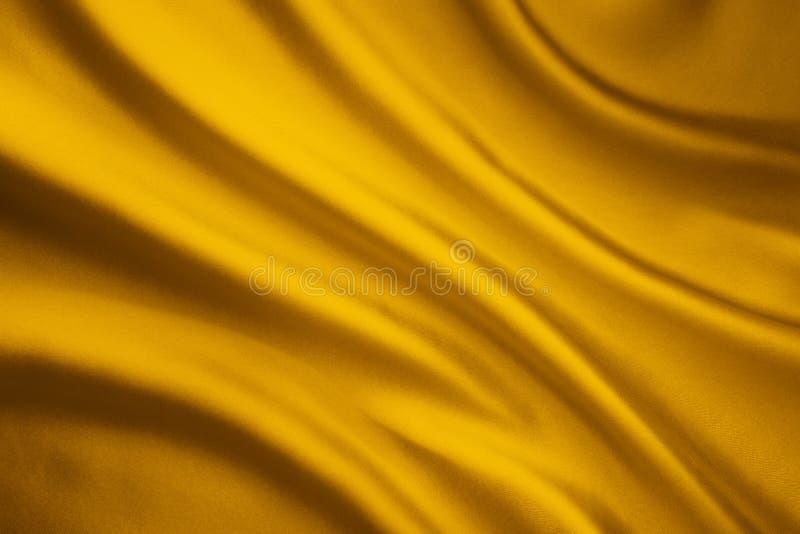 Fondo di Wave del tessuto di seta, struttura gialla del panno del raso fotografia stock libera da diritti