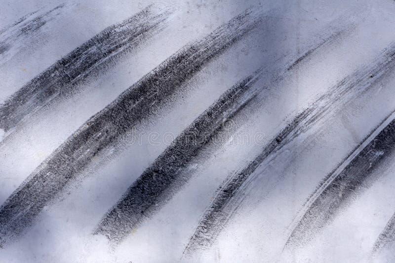 Fondo dipinto a mano astratto creativo grigio e bianco, carta da parati, struttura, frammento del primo piano di pittura acrilica immagini stock