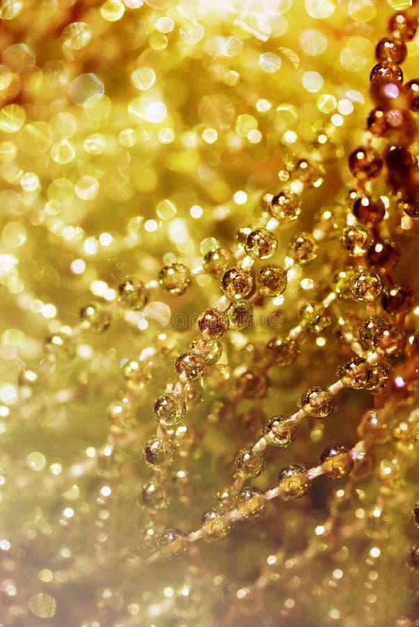Fondo dorato astratto della sfuocatura fotografia stock