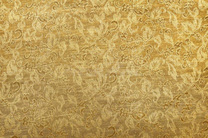 Fondo dorato cinese di struttura del tessuto dell'ornamento immagini stock libere da diritti