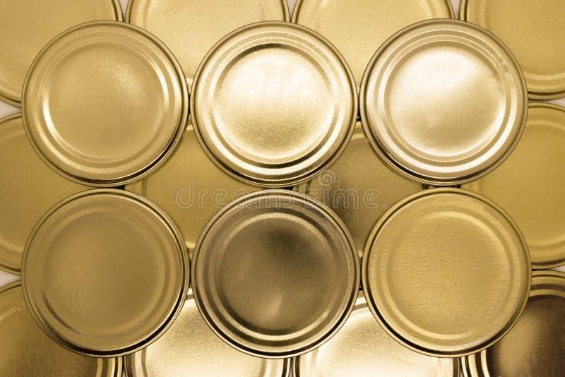 Fondo dorato dei coperchi del barattolo fotografia stock