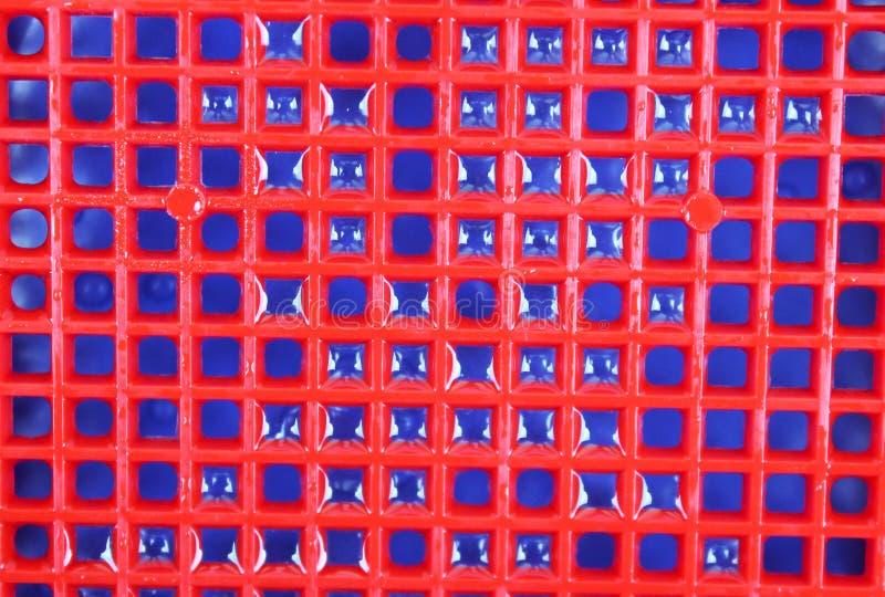 Fondo e struttura blu rossi con le goccioline di acqua fotografia stock