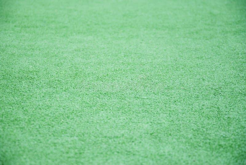 Fondo e struttura di bello modello dell'erba verde dal campo da golf fotografie stock libere da diritti