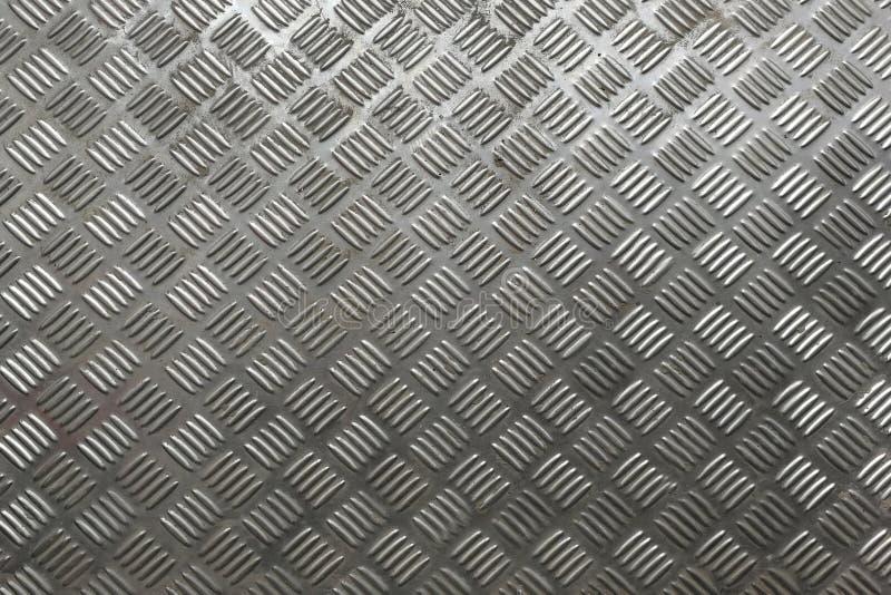 Fondo e struttura neri del metallo Piatto del diamante fotografie stock