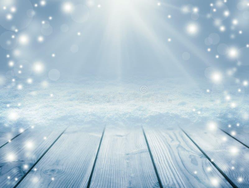 Fondo ed inverno di legno blu Tavola e bufera di neve vuote Chr fotografie stock