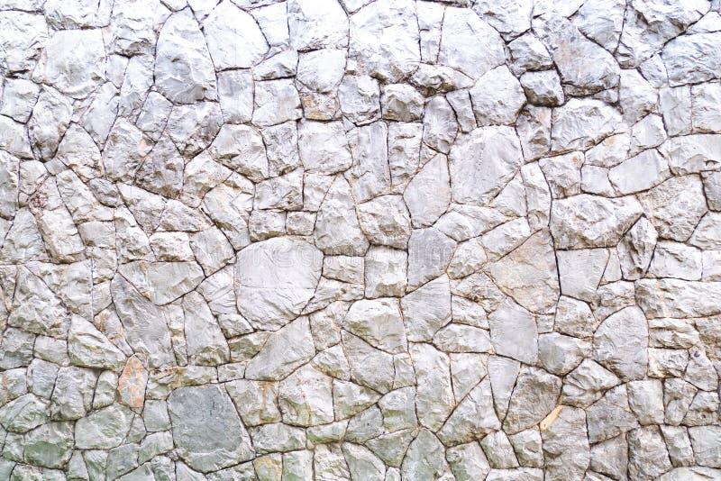 Fondo envejecido abstracto de la textura de la pared de piedra de la roca de pared en tono blanco y negro del color foto de archivo