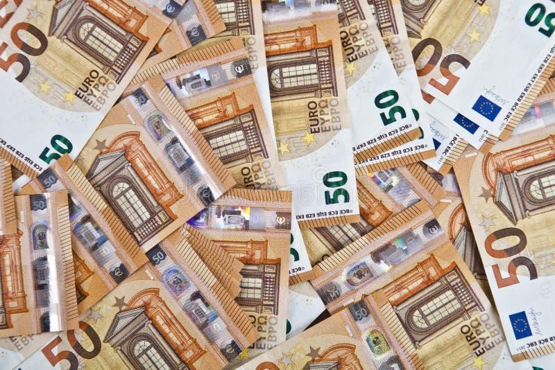 Fondo euro de cincuenta billetes de banco notas de la moneda 50€ foto de archivo libre de regalías