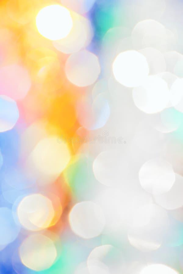 Fondo festivo con il bokeh multicolore di Natale fotografia stock