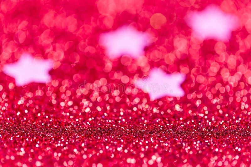 Fondo festivo di Natale con le stelle L'estratto ha scintillato brigh immagini stock