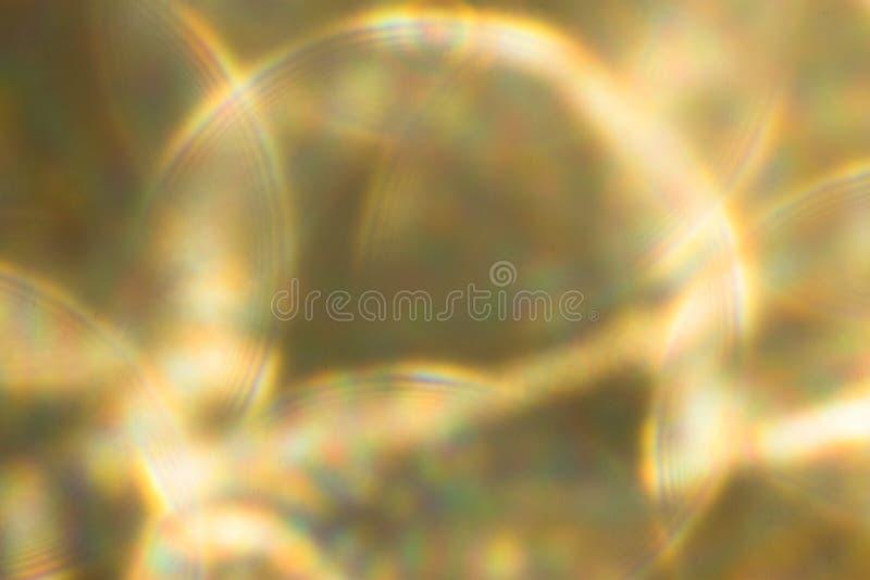 Fondo festivo metálico de las luces ámbar del oro La Navidad abstracta centelleó fondo brillante con las luces de plata defocused fotos de archivo
