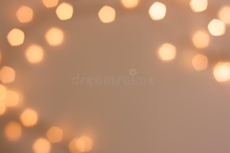 Fondo festivo scintillante dorato vago del bokeh fotografia stock libera da diritti