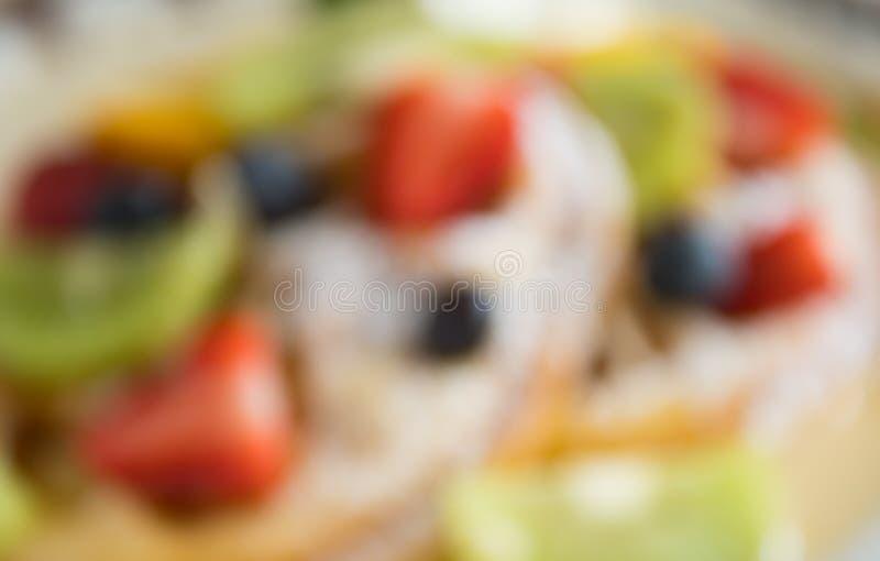 Fondo fruttato offuscante del dessert della cialda di stile per progettazione fotografie stock