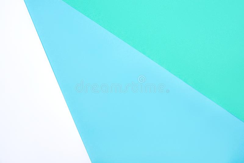 Fondo geométrico abstracto de cartón color blanco, verde y azul pastel imagen de archivo libre de regalías