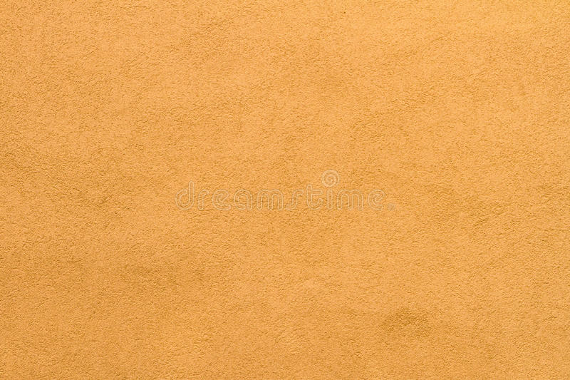 Fondo giallo carico pallido di struttura della parete dello stucco immagine stock libera da diritti
