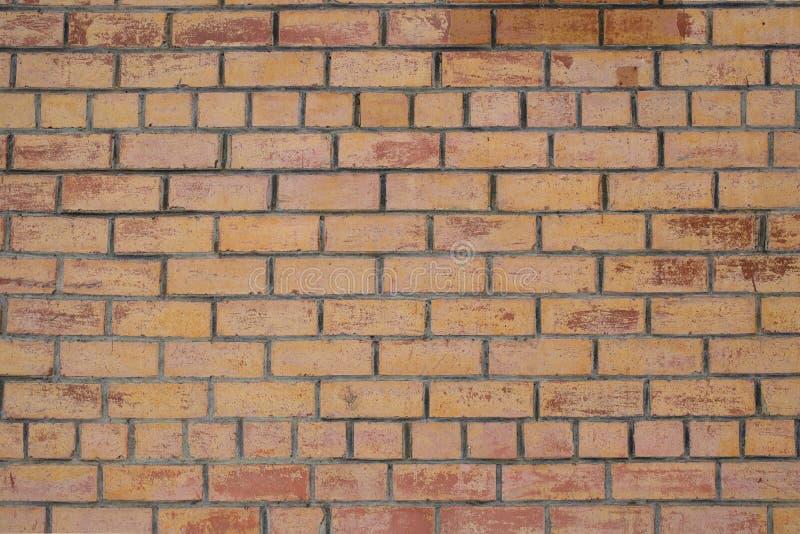 Fondo giallo di struttura della parete di mattoni immagini stock libere da diritti