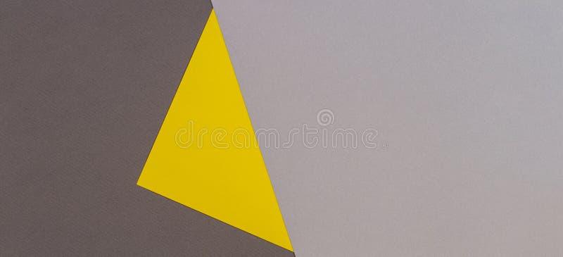 Fondo giallo e grigio della carta di colore Fondo d'avanguardia di carta geometrico astratto immagini stock