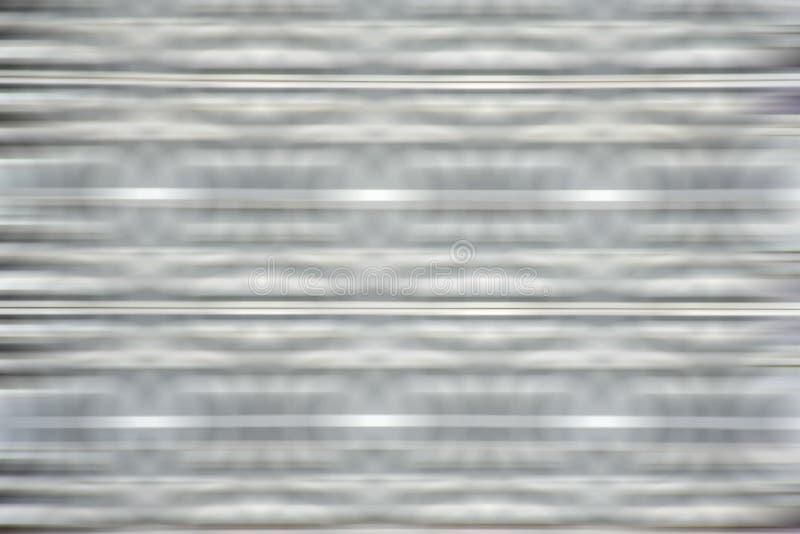 Fondo grafico di effetti della sfuocatura grigia bianca fotografia stock libera da diritti