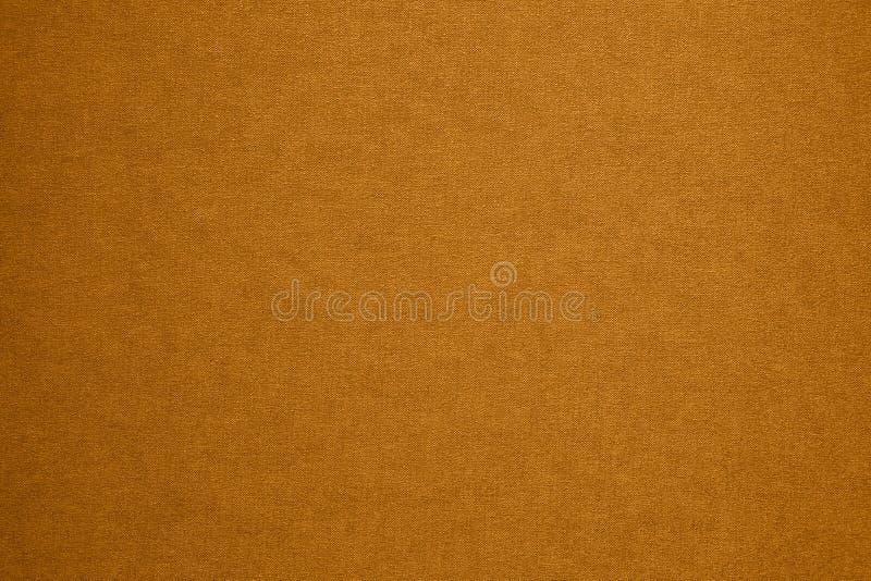 Fondo granulare artistico dell'oro strutturato fotografia stock libera da diritti