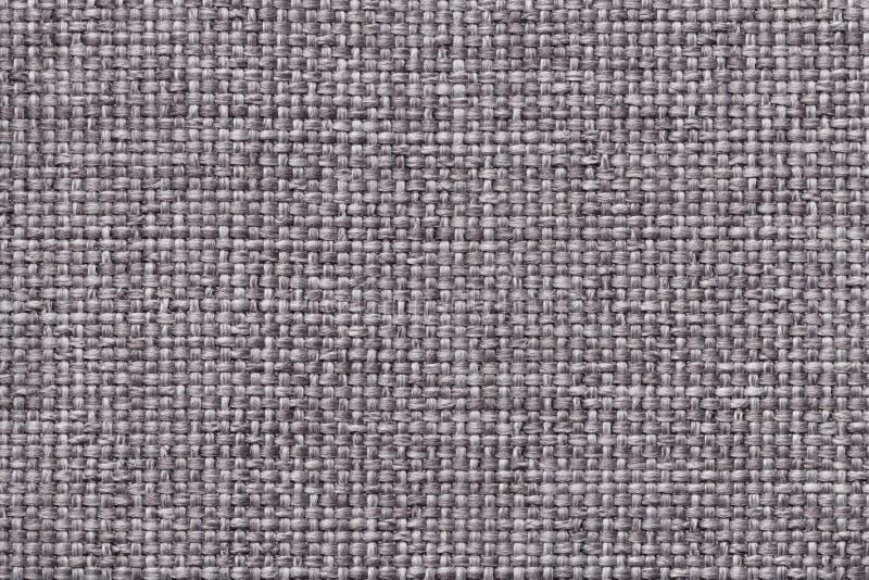 Fondo grigio con il modello a quadretti intrecciato, primo piano Struttura del tessuto di tessitura, macro fotografie stock