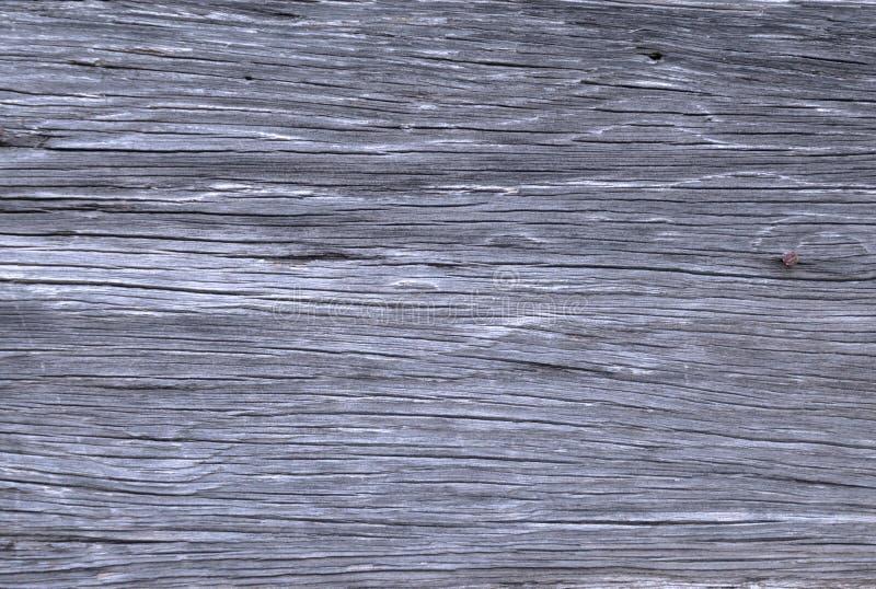 Fondo grigio grungy afflitto di legno dell'oggetto d'antiquariato del bordo del granaio fotografie stock libere da diritti