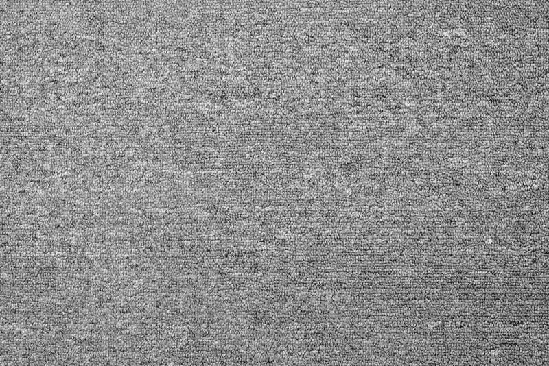 fondo grigio monocromatico di struttura del tappeto da sopra fotografie stock libere da diritti