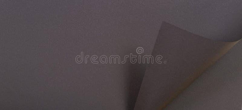 Fondo grigio scuro astratto dell'insegna di struttura della carta di colore fotografia stock
