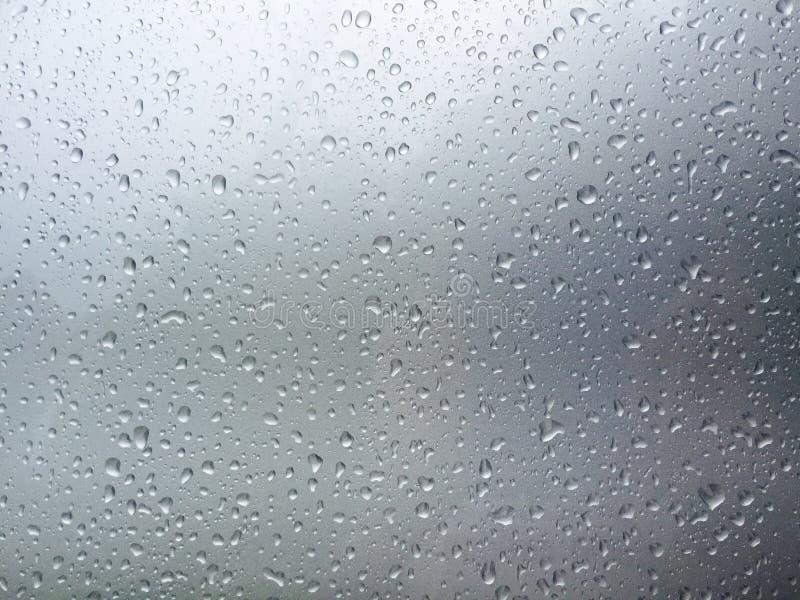 Fondo gris con descensos del agua imagen de archivo