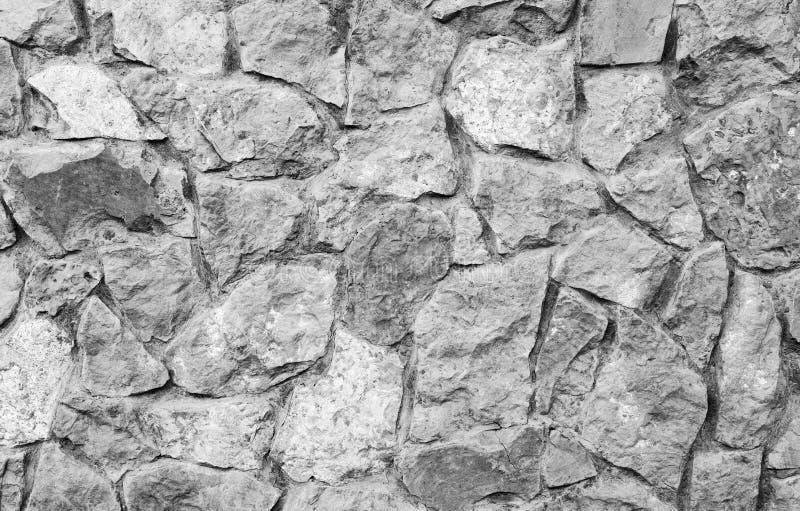 Fondo gris de pared de piedra Pared de ladrillo de piedra natural foto de archivo
