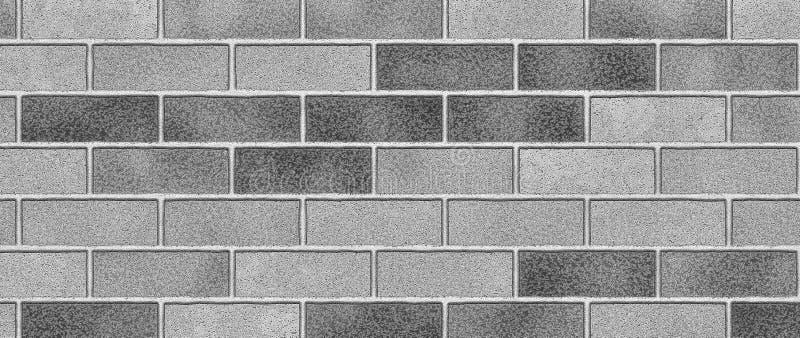 Fondo gris del extracto de la pared de ladrillo Textura de ladrillos imagen de archivo