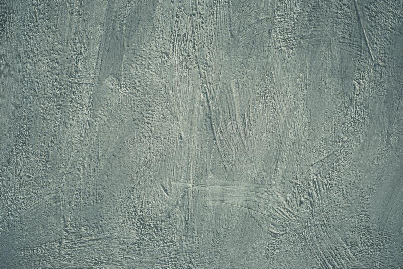 Fondo gris, muro de cemento del grunge Textura áspera áspera Pared pintada sucia Modelo de la pintura acrílica en tarjeta en esti imagen de archivo
