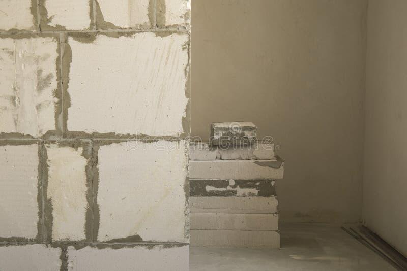 Fondo gris y blanco del muro de cemento del extracto del bloque de la pared de la textura fotografía de archivo