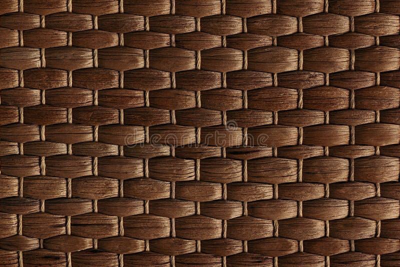 Fondo hecho a mano tejido bambú de la estera marrón Textura de madera de mimbre foto de archivo libre de regalías