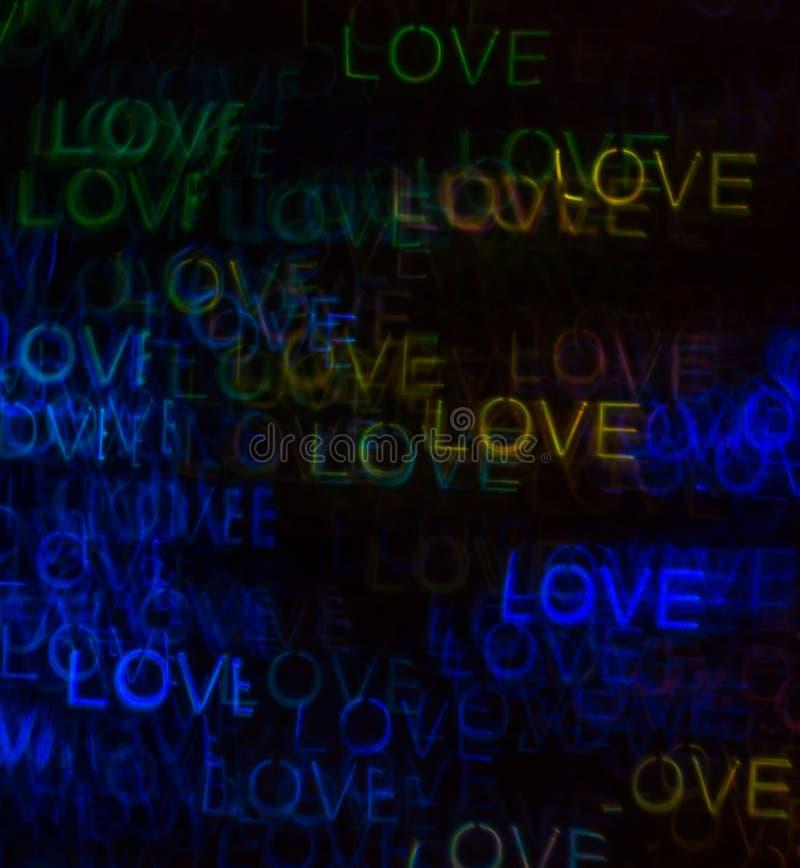 Fondo hermoso con diverso amor coloreado de la palabra, abstracto fotografía de archivo libre de regalías