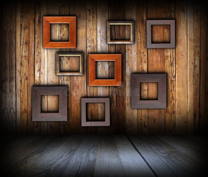 Fondo interior de madera con los marcos fotografía de archivo