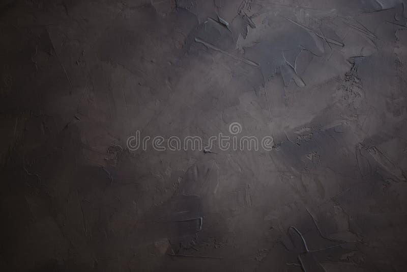 fondo intonacato scuro, fondo strutturato fatto a mano della foto fotografia stock libera da diritti