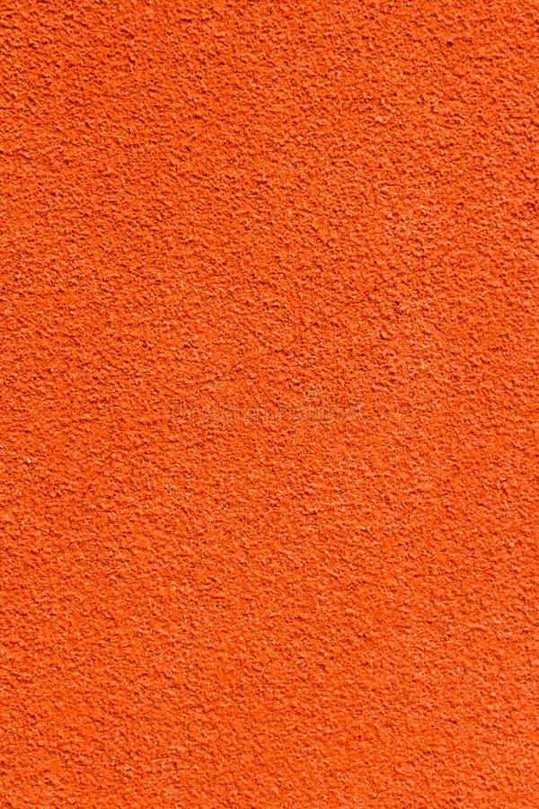 Fondo italiano arancio di struttura della parete dello stucco fotografie stock libere da diritti